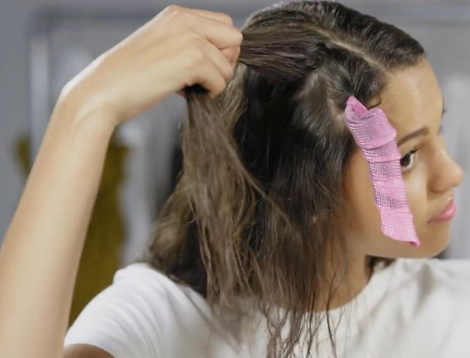 Отделение пряди волос